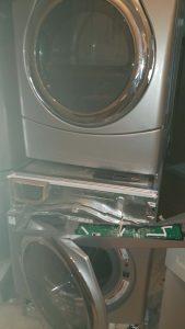 Our team performing appliance repair.