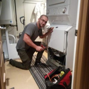 One of our team members repairing a home appliance.