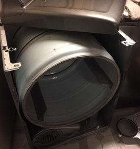 white tunnel inside of a washing machine